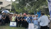 A rally of local health workers assemble to discuss the high prices of the new car park.