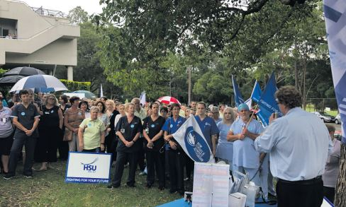 Hospital staff rally over increased parking fees and loss of