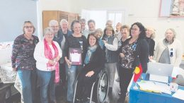 Jane Bowtell (left of centre) receiving her Gosford Woman of the Year Award from Liesl Tesch with Woy Woy CWA members