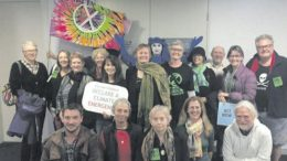 Supporters of the Climate Emergency declaration pose for the camera at the council meeting.