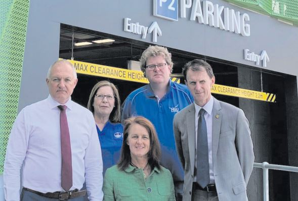 MPs David Harris (Wyong), Liesl Tesch (Gosford) and David Mehan (The Entrance) with workers at Gosford Hospital carpark